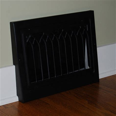vintage black cathedral style baseboard register