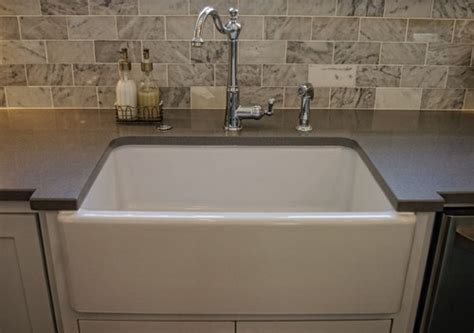 solid surface backsplash carrara subway tile backsplash with apron sink and gray solid surface countertops our new