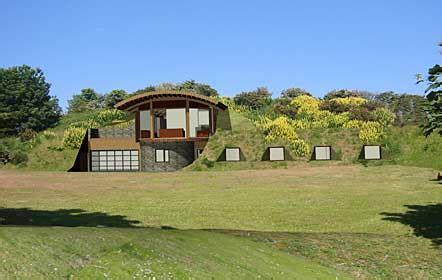 earth sheltered homes outlined mountainside  hillside