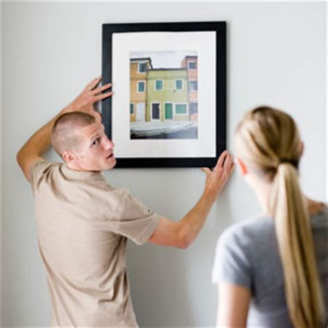 how to hang a canvas the proper way to hang a picture