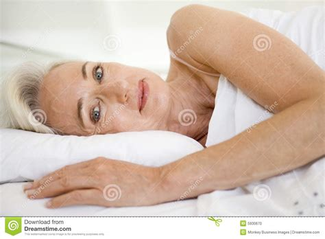 lying in bed woman lying in bed stock photo image 5930670