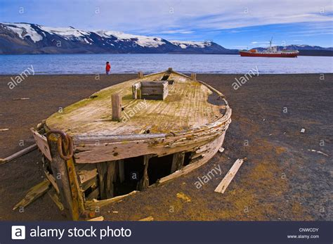 old boat on beach old wooden whaling boat on beach antarctica whalers bay