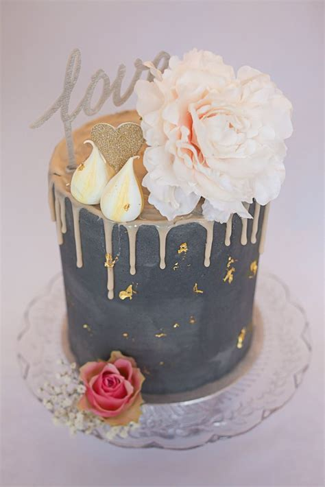 artisana bespoke cakes tall drippy grey cake  pale pink chocolate ganache drip topped