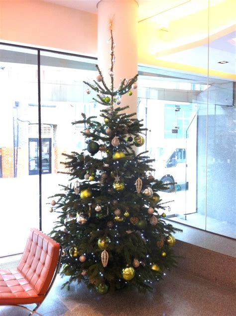 corporate christmas tree 10ft green and gold flowers