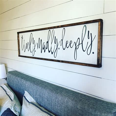 bedroom signs truly madly deeply above the bed sign this phrase of