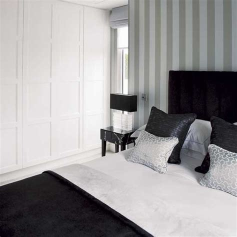 grey and white striped bedroom monochrome bedroom chic london apartment room designs