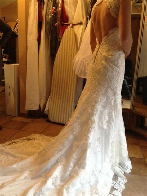 deep  cut  vintage style lace wedding dress features
