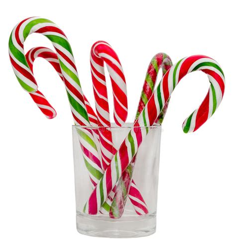 lollypop stick pictures xmas colored sticks and lollipops in a transparent glass isolated white background