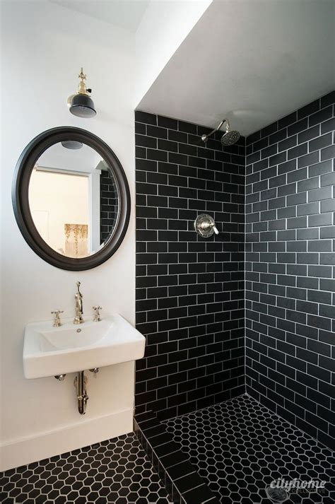 Modern bathroom black subway tile brass fixtures white wall mounted