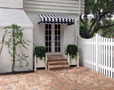 And White Striped Awning by Black And White Awning With Shrubs Shop Around