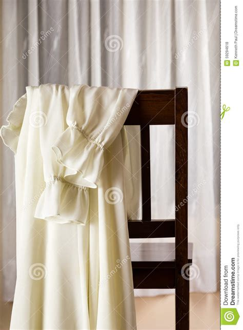 draped over white dress draped over chair stock photo image 59294618