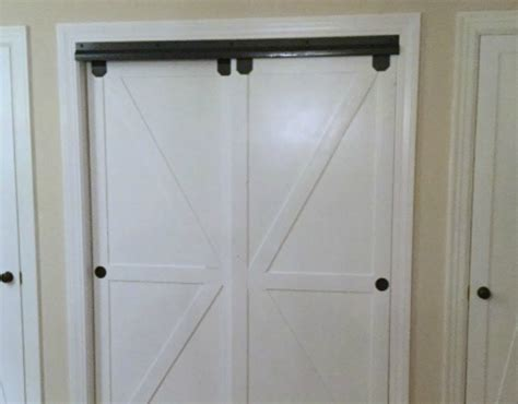 Faux Barn Door Remodelaholic How To Make Bypass Closet Doors Into Sliding Faux Barn Doors
