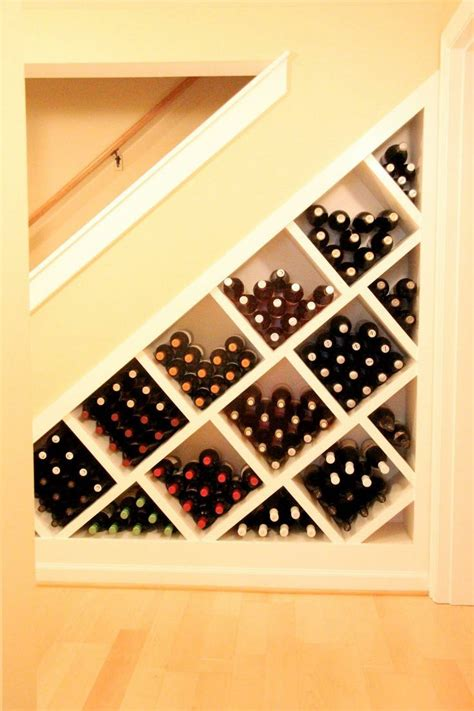 under stair case wine cooler basement remodel idea great use of space under the