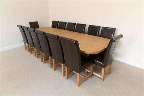 large  seater oak dining table set leather chairs