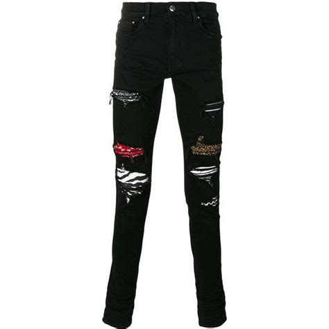 amiri patched  ripped skinny jeans