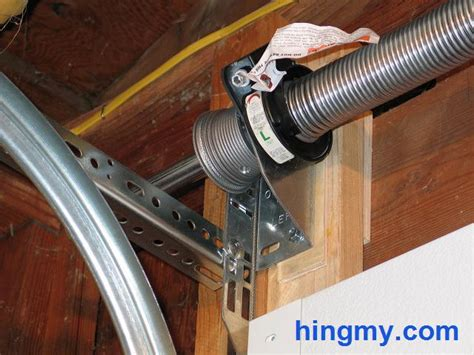 How To Wind Garage Door Cables by Installing Garage Door Torsion Springs