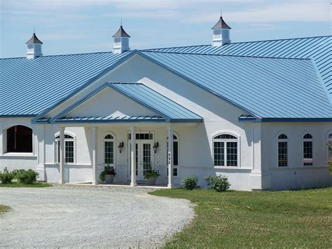 Cape Code Style House blue metal roofing precise buildings