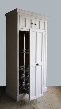 Free Standing Ironing Board Cabinet by 1000 Images About Kitchen Larder On Cupboards