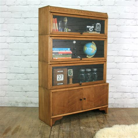 bookcase with cabinet on bottom book covers