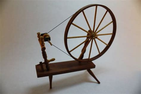Handmade Spinning Wheel - hold lacy dollhouse miniature handmade spinning wheel by