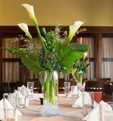 The Table Centerpieces Will Be Tall Vases At Varying Calla Table Centerpieces