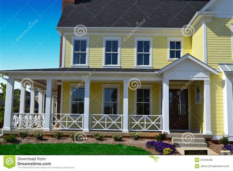 Cape Cod Home Designs yellow new england style home with porch stock image