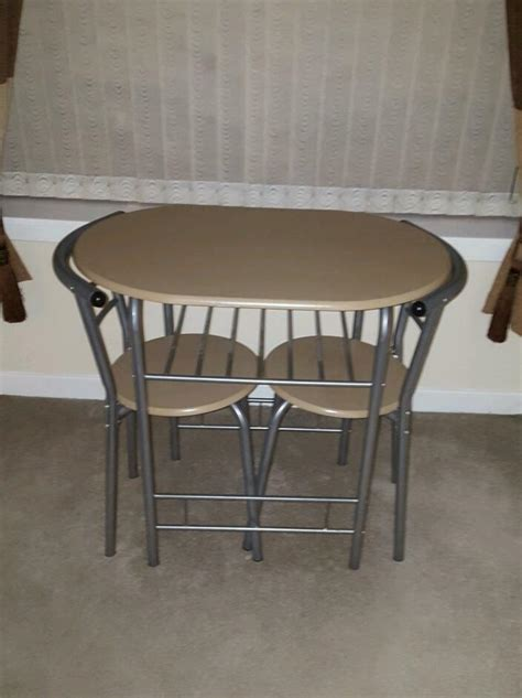 neat  seater dining table  tuck  chairs