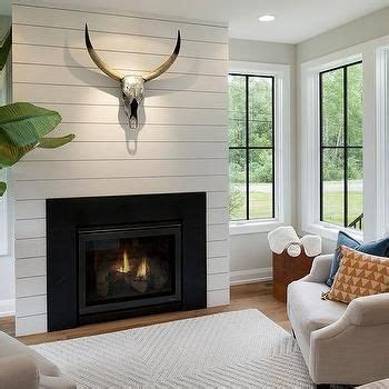 shiplap den shiplap fireplace wall with metal stag head fireplace