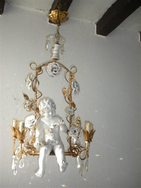 swinging from a chandelier french huge porcelain cherub swinging roses chandelier