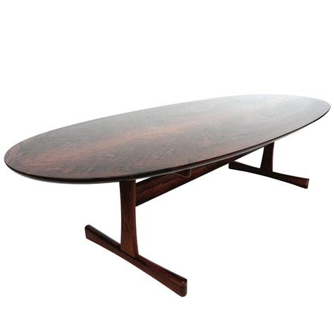 mid century oval rosewood coffee table in the style of