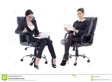 beautiful business women sitting  office chairs  table stock image image  computer