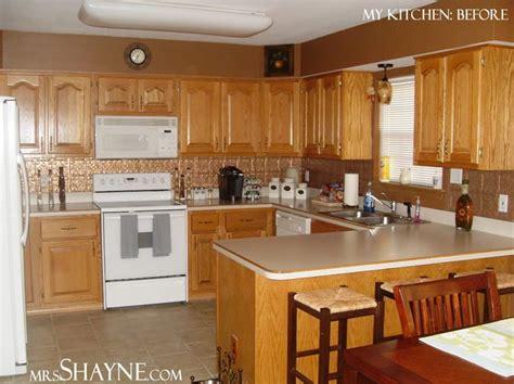 kitchen  grey walls  brown cabinets design advice