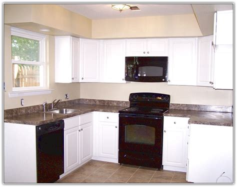Kitchens With White Cabinets And Black Appliances White Kitchen Cabinets With Black Appliances Roselawnlutheran