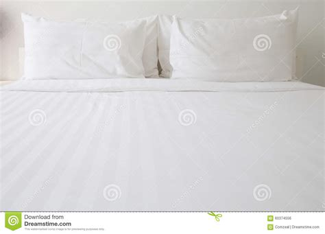 white bed pillows white bed sheets and pillows stock photo image 60374556