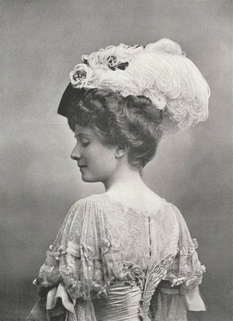 hair fashions from chosen era edwardian lady lace gown waved hair and feather hat
