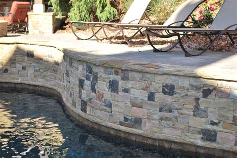 pin by heather mcbride on projects to try pinterest raised pool wall faced with stacked stone pool ideas pinterest