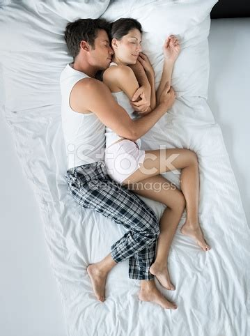 spooning in bed couple sleeping in bed spooning stock photo more