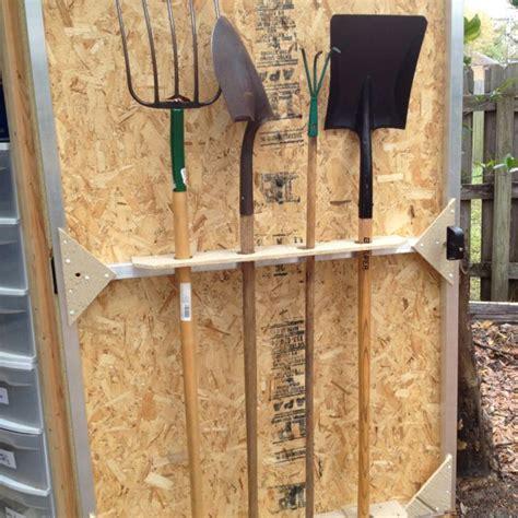 shed door doubles  shovel storage sheds  organizing