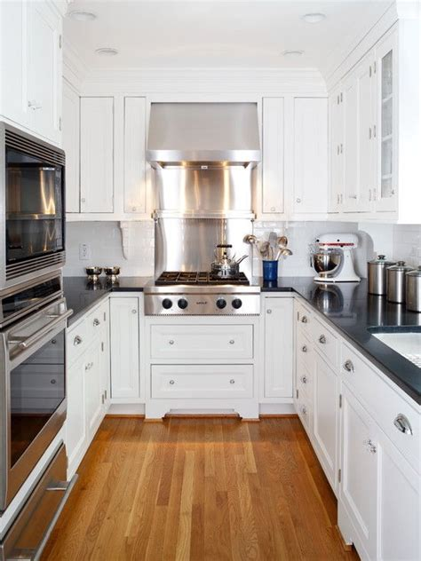 small white kitchen with steel hood galley kitchens kitchens and small kitchens on pinterest