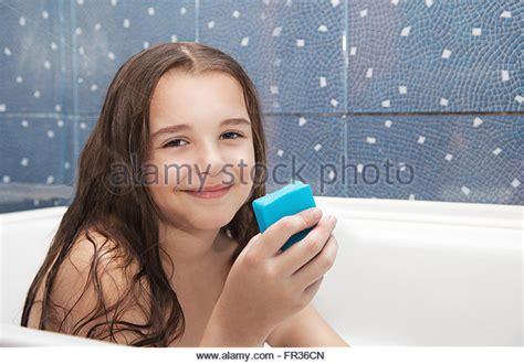 girl in the bathtub one girl bath bathroom water stock photos one girl bath bathroom water stock images