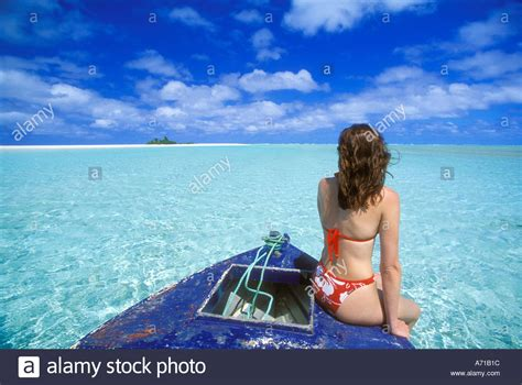 girl on bow of boat woman sitting on bow boat stock photos woman sitting on