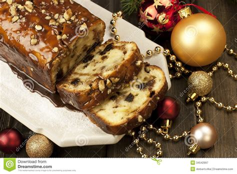 slice of christmas cake decorated with walnuts royalty