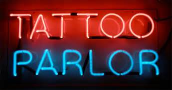 tattoo parlor let there be neon illuminated and non illuminated signs