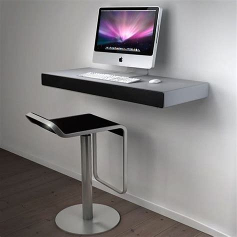 minimalist wall mounted imac desk on white wall