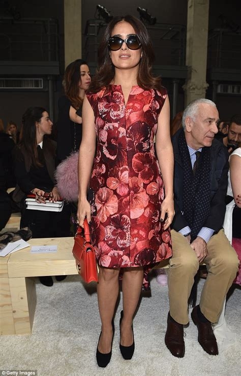 Queen Handbag by Salma Hayek Wows In A Red Floral Coat At Milan Fashion