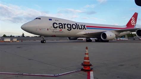 cargolux powered by expeditors landing and taxiing at sea tac