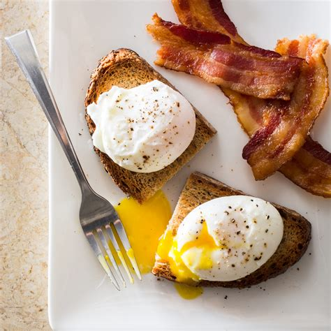 Pictures Of Poached Eggs poached eggs cook s illustrated