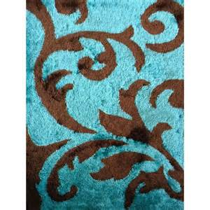 rug addiction tufted polyester turquoise and brown