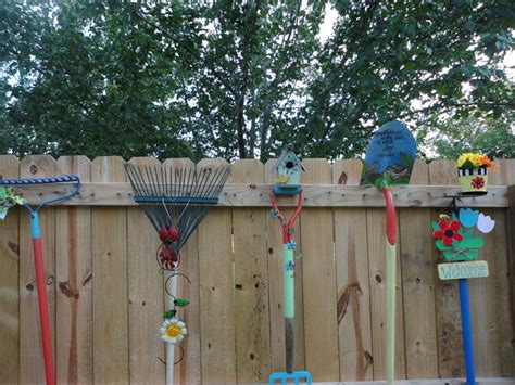 garden tools painted and decorated for fence