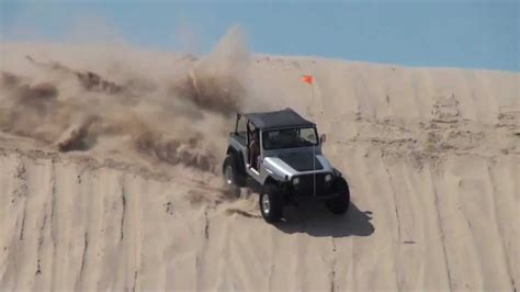 sand dune jeep jeep wrangler playing on test hill silver lake sand dunes